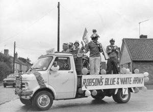Elmswell's Ipswich Town Football Supporters' Float Left to Right = Tim PEACHEY, Barry SCASE (with loudspeaker), and David PEACHEY Photo kindly provided by Barry Scase Barry Scase advises that it cost £80 to pay for two Securicor guards to guard the F.A.Cu