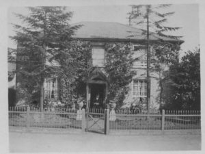 Peachey's Cottage, c.1922 Once called Peachey's Cottage - William Peachey lived there (seen sitting in garden); now (2002) Thurlow Nunn's offices