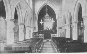 Inside St. John's, 1911 Gas lights hanging in aisle